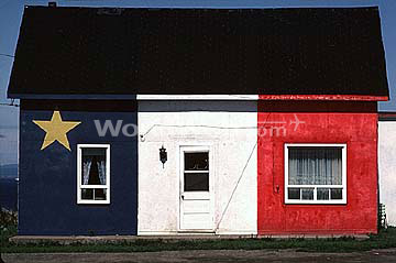 The Acadian Tricolour Flag Pointed on a Maritime Home