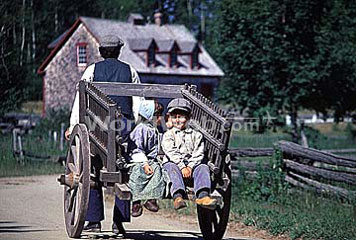 Kids Get a Wagon Ride at The Village Historique Acadien